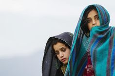 Picture of the Day: Ahmad Khel, Paktiya province, Afghanistan. Two Afghan girls watch the soldiers of Chosen Company, 3rd Battalion (Airborne), 509th Infantry during a helicopter assault mission. July 16th.  Credit: Lucas Jackson/Reuters.