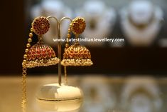 Classic south Indian temple jewellery design ruby jhumkas adorned with Burmese rubies and small basara pearls in bunches throughout. Gold Jhumka Earrings, Jewelry Design Earrings, Gold Earrings Designs, Ear Jewelry, India Jewelry, Italian Gold Jewelry, Gold Jewelry Simple, Saree Jewellery, Temple Jewellery
