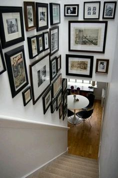 Nothing says home and love like a photo wall. Check out these 50 amazing photo gallery wall ideas and learn the best way to photos for your wall gallery. Decoration Cage Escalier, Gallery Wall Staircase, Gallery Walls, Stairwell Pictures, Frame Gallery, Art Gallery, Staircase Frames, Staircase Walls, Stairway Photos