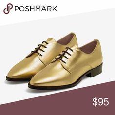 Golden Oxford shoes by Uterqüe (Zara Luxury) Golden oxfords by Uterqüe. New in box. Size euro 37, so by Zara's rule of thumb, it's a US 6. Uterqüe Shoes Flats & Loafers