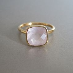 This stunning rose quartz square stone is so pretty. This ring features a sleek smooth bezel, perfect for stacking. Metal: 18kt gold vermeil Gem: 10 x 10mm quartz Band: 1.8mm round band / high shine f