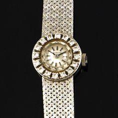 Orologio Zenith da donna; in oro bianco 18 kt, cassa tonda, quadrante color perlka impreziosito da corona di brillanti, cinturino lavorato a tessuto, gr.26, L. 16 cm
