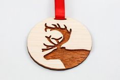 Deer Ornament - Plywood & Cherry (Laser Cut). $12.00, via Etsy.    Fun series when white part is other colors...red, light blue, etc.
