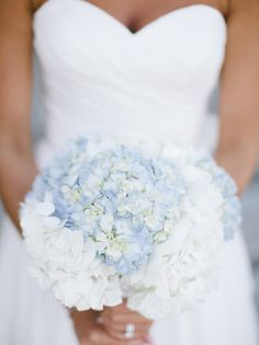 20 Something Blue Wedding Bouquets | SouthBound Bride | http://www.southboundbride.com/something-blue-wedding-bouquets | Credit: Keepsake Memories Photography via The Knot