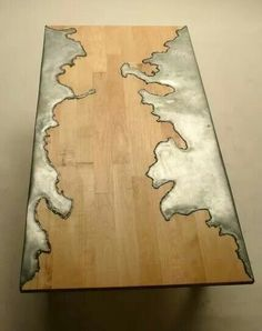 The beautiful freeform metal inset in this wood table looks geographic. Wood and Steel Table Unique Furniture, Wood Furniture, Furniture Design, Furniture Stores, Outdoor Furniture, Cheap Furniture, Industrial Furniture, Metallic Furniture, Furniture Dolly