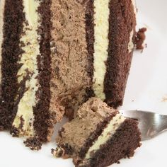 A Rich and fluffy four layer chocolate cake with chocolate mousse and white chocolate frosting.