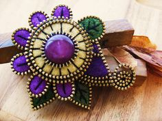 Jewelry inspiration. A lovely mauve/purple by woolly  fabulous, via Flickr