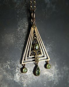 An exquisite Art Deco pendant & chain set with peridots and seed pearls. New to the site CJAntiquesLtd.com