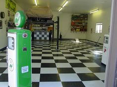 Garage floor and car lift. Repinned by Greased Lightning Garages, Melbourne.  http://www.secretdesignstudio.com/Greased-Lightning-Garages.html