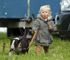 Savannah Phillips takes the lead with Princess Anne's dog - a pretty darn cute great-granddaughter for the Queen