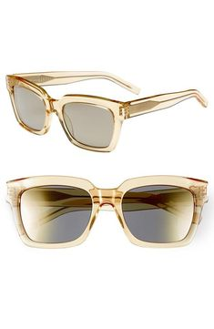 Feeling retro in these yellow Saint Laurent sunglasses.