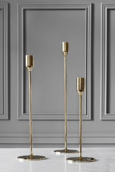 """Richard Hutten is one of the most internationally successful Dutch designers; a key exponent of """"Droog Design"""", in which he has been involved since it's inception in For Skultuna Richard Hutten has designed this elegant candlestick made of highly po Chandeliers, Modern Decor, Modern Furniture, Modern Lamps, Deco Table, Messing, Elegant, Scandinavian Design, Candlesticks"""