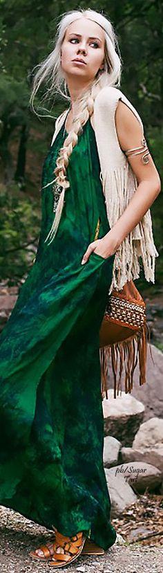 de kleur van de jurk en de zakken in de jurk