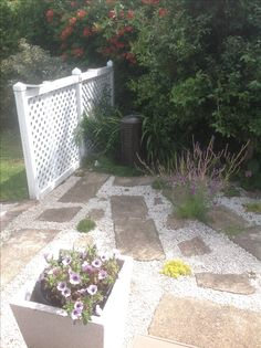 Stepping stones and white chip. Solar copper water feature...recycled hot water cylinder.