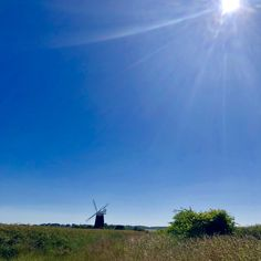 Windmill, big blue skies - sums up North Norfolk perfectly!! Book your dog and child friendly holiday in North Norfolk now - link in bio