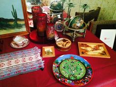 Found on EstateSales.NET: Candle Holders, Charger, Artwork, Vanity Powder Box, Handprinted Plate, Desk Globe, Tea Cup, and More