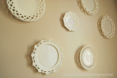 how to hang plates on a wall using paper plate templates and paper clips for easy hanging...genius!