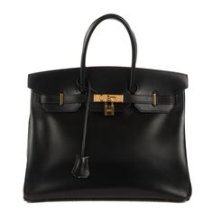 This authenticHERMES Box Birkin 35 in Noir Black is crafted of beautifully polished box calfskin leather. The bag features rolled leather top handles, a cross over flap and strap with a plated gold turn lock and padlock. There is a hanging pochette with keys to open theflap to aspacious leather interior, ideal for every occasion, from Hermes.