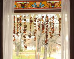 Decorate the window for fall with leaf garlands