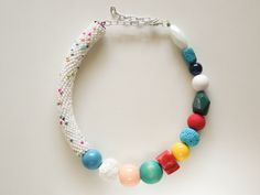 Multi color asymmetric necklace with crocheted seed beads and other big handmade beads. #ivadidit