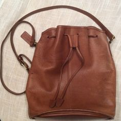 """Vintage Coach!!! Coach drawstring. I've done a lot of research and the best I can tell it's named Lulu's Legacy"""". It's nicely worn. Note the blue dot on the left. There is a small lighter one on the back. Let me know if you want a pic. I'll miss her! Coach Bags Shoulder Bags"""