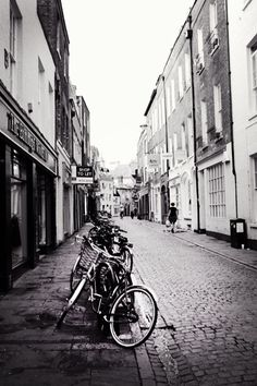 Black and white photo with bikes.