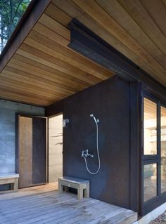 Modest cabin the woods.  Not a fan of an outdoor open shower.  This could he enclosed.