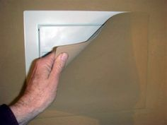 This secret wall safe from ConsoleVault includes a magnetic cover that can be painted to match your wall color. This can work well in low traffic areas, utility closets, garages, etc.