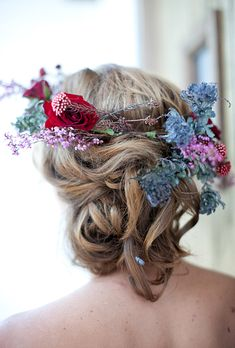 Brides.com: . The straight-from-the-garden look of this flower crown by Petal Floral Design goes perfectly with the bride's romantic but messy chignon hairstyle.