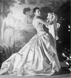 Dorian Leigh, 1955  Photographer: Henry Clarke  Gown by Jean Patou - This would be a lovely wedding dress!