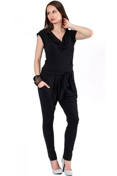 Black jumpsuit with short sleeves and bare back. The jumpsuit comes with a belt from the same fabric.