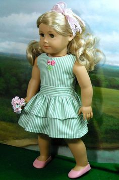 Spring Dress and Sweater for 18 inch Girls like Lanie, Isabelle, Saige. This pretty little green and white striped cotton dress has a lined, fitted bodice adorned with floral embroidery and a double tier skirt.