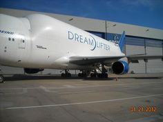 Dreamlifter, transport airplane for the 787. The Dreamlifter is the biggest cargo plane in the world, just not commercial.  Carries the front part of the 787 to Washington State for assembly. If you were to put floors in it, it would have 3 levels plus cargo below.