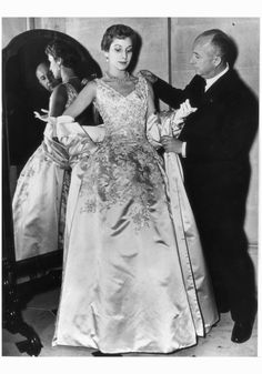 Christian Dior Dior arranging one of his a satin evening gown called Blenheim. , Marie-Thérèse Walter Lucie Daouphars