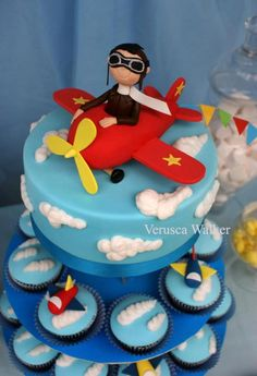 Chocolate cake and cupcakes decorated with fondant. Airplane Cake and Cupcakes Fondant Cakes, Cupcake Cakes, Cupcake Tier, Airplane Birthday Cakes, Airplane Cakes, Airplane Party, Planes Cake, Pool Cake, Alice In Wonderland Cakes