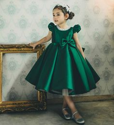 Pearl Applique Dress-Made To Order - High Quality Pearl Applique Cap Sleeve Tea Length Bow Back Baby Infant Toddler Little & Big Girl Party Dress. Perfect dress for your little flower girl, birthday party or any occasion. Available from 9 month until 13 years. Material: Cotton, soft polyester fiber, tulle mesh, satin. Color: Dark Green. Please do compare your  little girl measurements with our size chart.