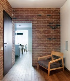 Impressive Interior Design House by Lungerin Architects: Interesting Space Inside The Studio Apartment With Brown Brick Wall And Hardwood Fl...