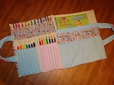 Coloring book/crayon caddy - maybe add 2 sliding pockets on each side to slip the covers of the coloring book into?