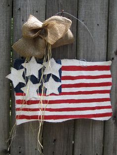 Burlap USA Flag Red, White and Blue Burlap Door Hangers American Flag with Stars. $28.00, via Etsy.