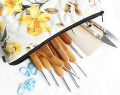 Crochet hook set with bamboo handles, clippers, stitch markers, needles and softly printed flower pattern zipper pouch. Crochet hook set, crochet kit, crochet bag, travel set, Etsy store, craft as therapy