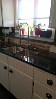 Sink and faucet in, back splash next
