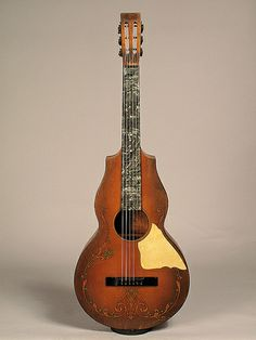 """Regal - A very unusual 6 string instrument from the 1920s. At one point it was in the Regal catalog as a """"lute guitar', but it was actually made to be played on the lap with a steel bar."""