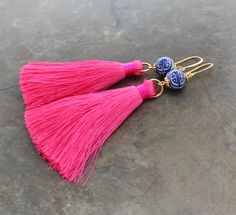 ~ Lush pink silk tassels dangle from a Chinoiserie style ceramic bead and are finished with french hook ear wires.  ALso available in white - please see the drop down menu for tassel color options.   Need more? I offer a tiered discount for ordering in multiples - please send a message for details.  Your earrings will arrive in a lovely kraft gift box with a ribbon, ready for gift-giving.   ~~~~~~Please see my shop policies on turnaround time and shipping before placing your order. Thank…
