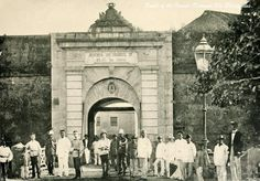 Spanish military and civil officials in front of Puerta de Isabel II. The huge man, from right, is unidentified. Part of Colegio de San Juan de Letran is visible through the gate Philippine-American War, Fort Santiago, Philippine Architecture, Jose Rizal, Intramuros, Filipino Culture, Bataan, American War, Spanish Colonial, Facade House