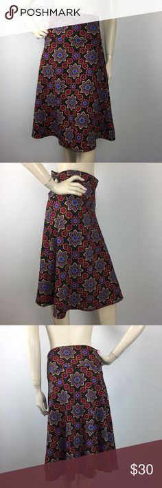 """Lularoe Azure Multicolor Geo Floral Skirt Medium CONDITION: New without tags. MATERIAL: 97% Polyester 3% Spandex COLOR: Black,Gray,Red,Yellow,Aqua Green and purple (Please note that the measurements are approximate) ALL MEASUREMENTS ARE TAKEN WITH GARMENT LYING FLAT: WAIST: 15"""" HIPS: 19"""" LENGHT: 26"""" LuLaRoe Skirts A-Line or Full"""