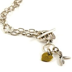Danon Silver Necklace With Silver Dragonfly And Bronze Heart Charm | lizzielane.co.uk. http://www.lizzielane.co.uk/shop/danon-silver-necklace-with-silver-dragonfly-and-gold-heart-charm. £39