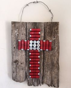 Shotgun Shell Cross on Barnwood by RancherGirlDesigns on Etsy - Sea Shells, Sea Shell Crafts, Sea Shell Jewelry - amazing craft Redneck Crafts, Ammo Crafts, Hunting Crafts, Shotgun Shell Art, Shotgun Shell Crafts, Shotgun Shells, Shotgun Shell Wreath, Shotgun Shell Jewelry, Bullet Jewelry