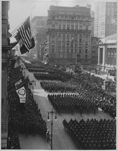Overseas men welcomed home. Parade in honor of returned fighters passing the Public Library, New York City,1917 - ca. 1919