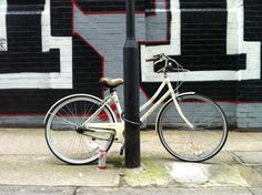 pale yellow bike 1, with can of red stripe, london