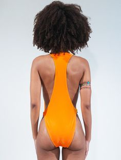 27228516dbf5a 2 Angela Simmons s Barbados Andrea Iyamah One Piece Orange Issa Swimsuit.  Forget the front of